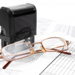 Press and glasses on documents. — Stock Photo