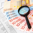 Stock Photo: Magnifiers and denomination euro on documents.