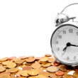 Alarm clocks and gold coins. — Stock Photo