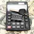 Stock Photo: Keys from car on money.