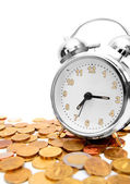 Alarm clock on gold coins. — Stock Photo