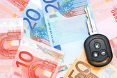 Keys from car on euro banknotes. — Stock Photo
