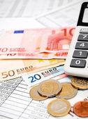 Coins, the calculator . — Stock Photo
