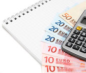 Money (euro) and the calculator for a notebook. — Foto Stock