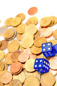 Gold coins and dices. — Stock Photo