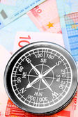 Compass for euro banknotes. — Stock Photo