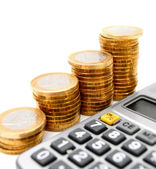Coins graph and calculator . On white. — Stock Photo