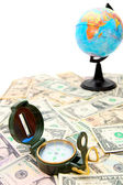Compass and the globe on dollars. — Stock Photo