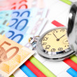 Stock Photo: Watch and banknote euro on graphs.