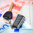 Key from the car and euro. On documents. — Stock Photo