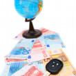 Key from the car and globe for euro banknotes. — Stock Photo