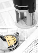 Stamp and watch on the documents. — Stock Photo