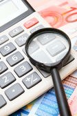 Calculator and magnifier for euro banknotes. — Stock Photo