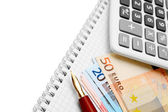 Pen, the calculator and banknote euro — Stock Photo