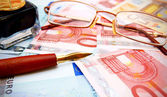 Pen and glasses for euro. — Stock Photo