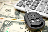 Key from the car and calculator — Stock Photo