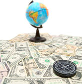 Compass and globe on dollars. On a white background. — Stock Photo