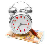 Alarm clock, pen and a pack of money. On a white background. — Zdjęcie stockowe