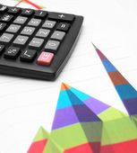 Calculator on graphs. — Stock Photo