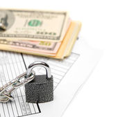 Packs of dollars, documents and chain with the lock. — Stock Photo