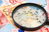Magnifier and puzzle for euro banknotes. — Stock Photo
