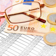 Glasses and euro on documents. - Stock Photo