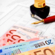 Euros of a denomination and pen on documents. — Stock Photo