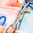 Stock Photo: Chains and banknote euro.