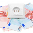 Electric sockets and banknote euro. On a white background. - Stock Photo