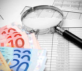 Magnifiers and euro on documents. — Stock Photo