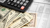 Dollars and the calculator on documents. — Stock Photo