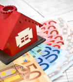 Euros of a denomination and toy house — Stock Photo