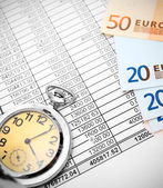 Watch and euro on documents. — Stock Photo