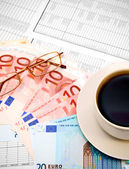 Cups of coffee and money on documents. — Stock Photo