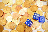 Dices on coins. — Stock Photo