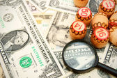 Magnifiers and lotto on dollars. — Stock Photo