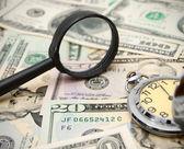 Lupa y relojes en dólares. — Foto de Stock