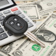 Stock Photo: Key from car and calculator on money.