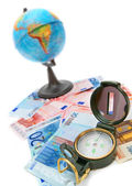 Compasses, money and the globe on a white background. — Stock Photo
