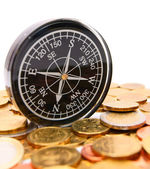 Coins and a compass. — Stock Photo