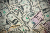 Background from dollar denominations. — Stock Photo