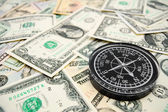 Compass on the dollars. — Stock Photo