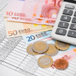 Euros money, the calculator and documents. — Stock Photo