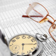 Watch and glasses on documents. — Foto Stock #31578153