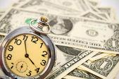 Watch on money. — Stock Photo