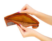 Empty purse in a hand. On a white background. — Stock Photo