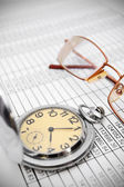 Watch and glasses on documents. — Foto Stock