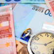 Watch on the euro banknotes. — Stock Photo