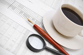 Coffee and pen on the documents. — Stock Photo