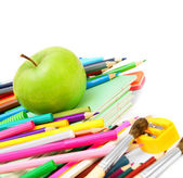 Back to school. An apple and school accessories on a white background. — Stockfoto